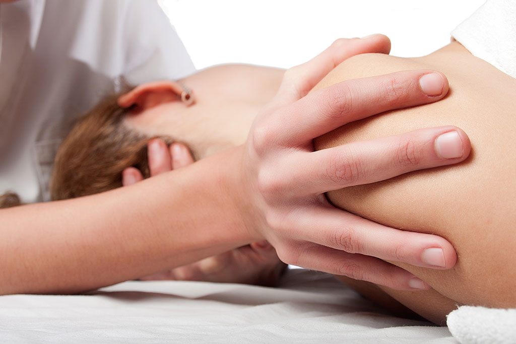 Osteopath in session with patient
